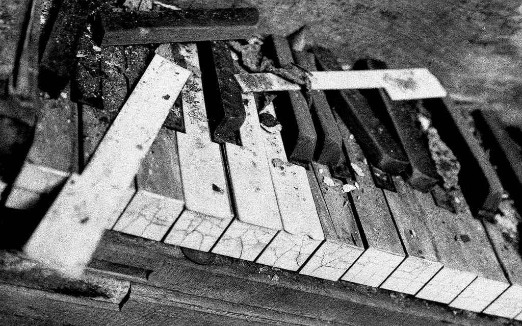 piano abandoned broken weathered lost  black and white film photography Johnny Martyr