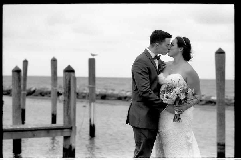 Black and White Film  black and white film photography wedding marriage bride groom dock pier water waterfront seagull dress love kiss flowers scenic