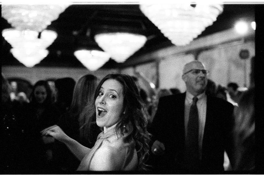 dance smile laugh film grain black and white film photography wedding reception dance maryland