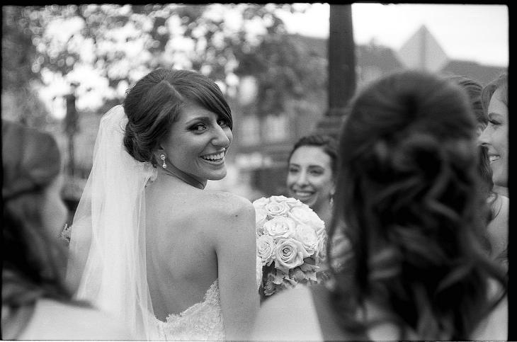 wedding bride photographer film black and white happy smile shoulder veil train dress white happy maryland frederick baker park crowd party johnny martyr nicole azat