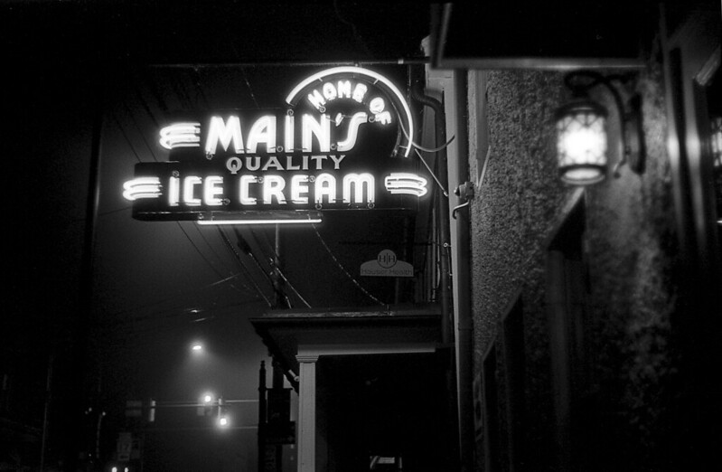 Main Cup restaurant Main's Ice Cream Quality Home of Middletown Maryland Main Street West Main Street small down neon sign night leica 35mm film black and white johnny martyr photograph classic timeless 1940's 1950's 40s 50s 30s 1930's sign lit light glow
