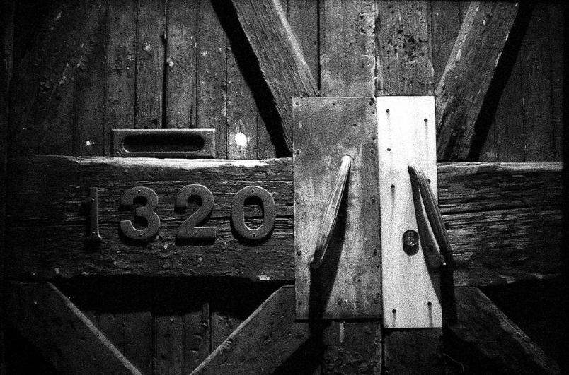 1320 door rustic wood metal old vintage weathered black and white film photography