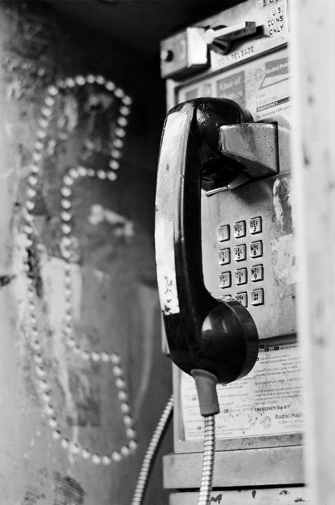 Beat Up Weathered Payphone in b&w black and white film photography Johnny Martyr